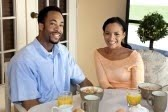 5839641-a-happy-african-american-man-and-woman-couple-in-their-thirties-sitting-outside-having-a-healthy-bre.jpg