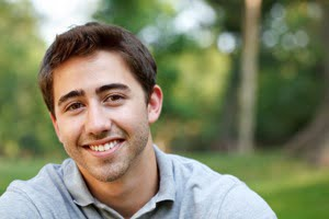 young-man-smiling-outside.jpg