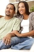 9150648-a-happy-african-american-man-and-woman-couple-in-their-thirties-sitting-at-home.jpg