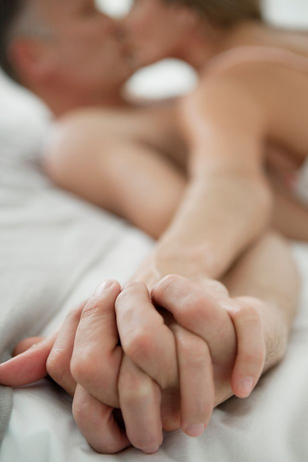 Couple-romancing-on-the-bed.jpg
