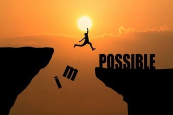 man-jumping-over-impossible-or-possible-over-cliff-on-sunset-background-business-concept-idea_1323-266.jpg